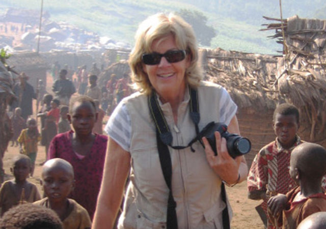 Sally Armstrong smiling with camera around her neck