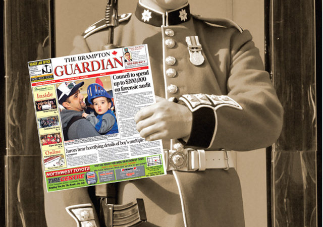 The Brampton Guardian newspaper held my solider in uniform in black and white photo