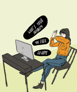 Woman sitting at computer with mean speech bubbles coming out of computer