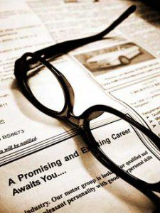 Newspaper with eye glasses on top