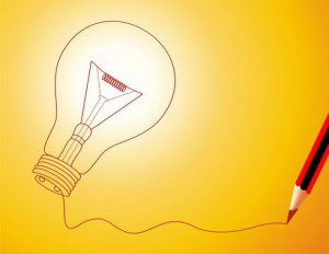 A pencil drawing a lightbulb