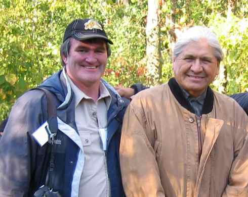 Peter Edwards stands next to man smiling
