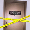 Door saying Darfur with yellow tape across it