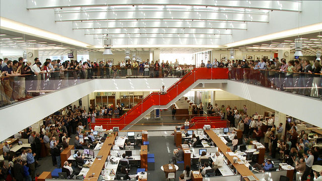 Crowd of people in office space