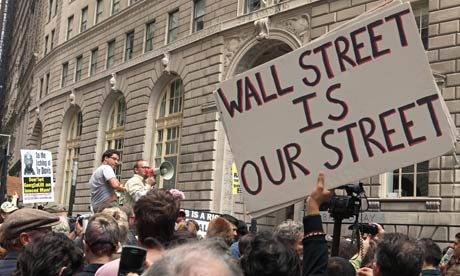 "Protest with sign saying ""Wall Street is Our Street"""