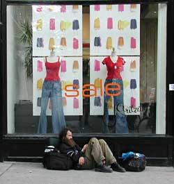 "Homeless man on sidewalk outside of Aritzia window saying ""sale"""