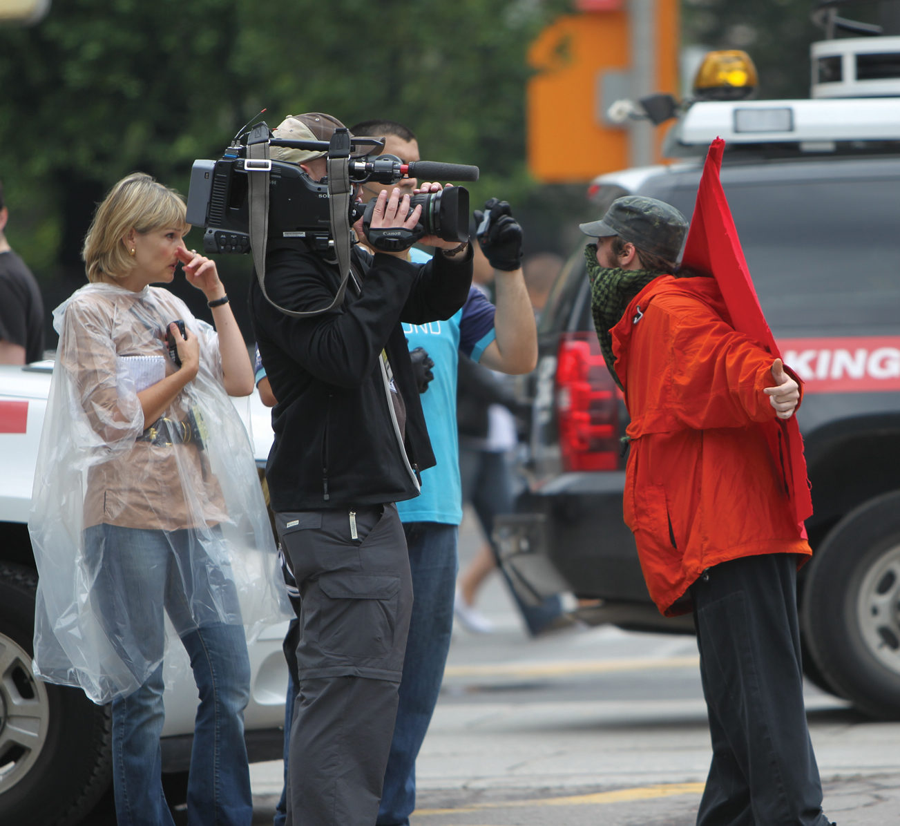 Camerman and citizen wearing red