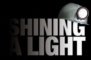 Shining a Light logo with construction helmet and light