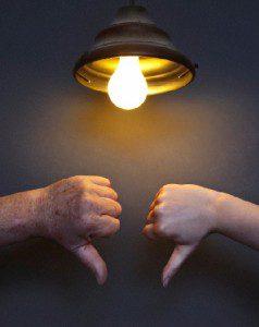 2 thumbs down under lightbulb