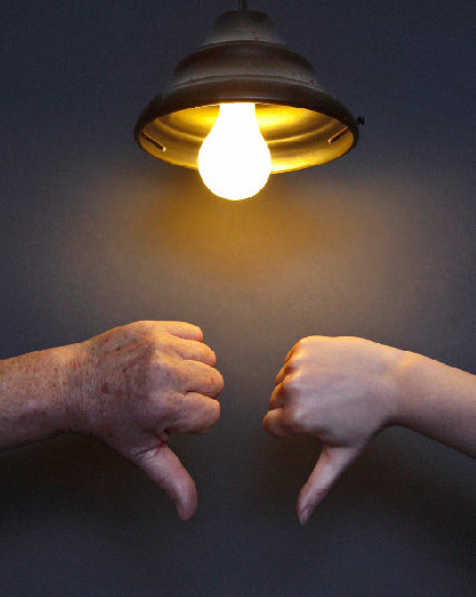 2 thumbs down under lightbulb