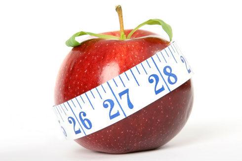 Measuring tape around apple