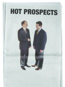 """""""Hot Prospects"""". Two men in suits laugh together"""