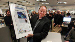 "Toronto Star ""Goodboy newsboy"" article framed held by man"
