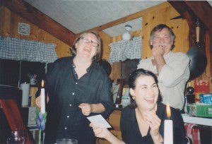 Don Obe and two women laughing