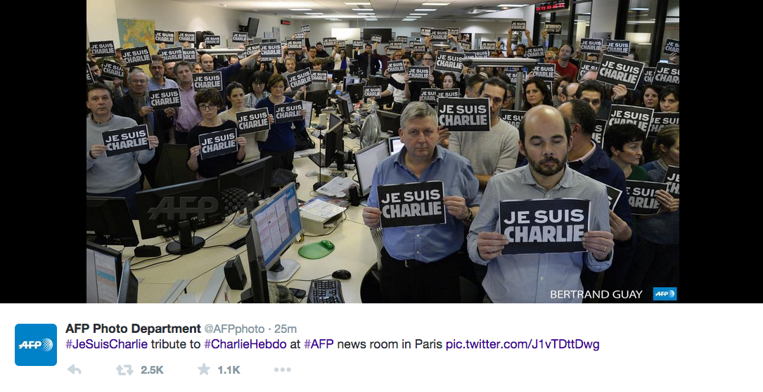 "People in office holding signs saying ""Je Suis Charlie"""