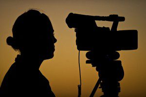 Silhouette of man and camera