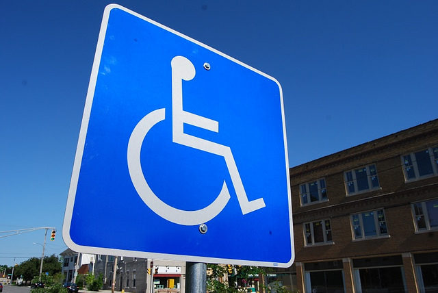 Accessible parking space sign
