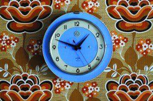 Clock on decorative wallpaper