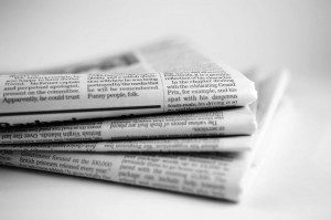 A stock image of a stack of newspapers