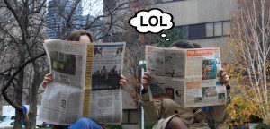 """Women reading newspapers bubble from one woman says """"LOL"""""""