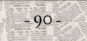 """90"" with background of newspapers"