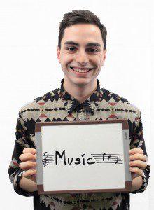 "Man holds whiteboard ""Music"""