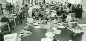 People working in newsroom