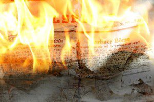 Newspapers on fire