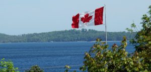 Canadian flag by lake