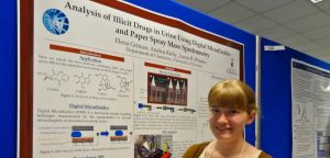 Girl smiling in front of science presentation