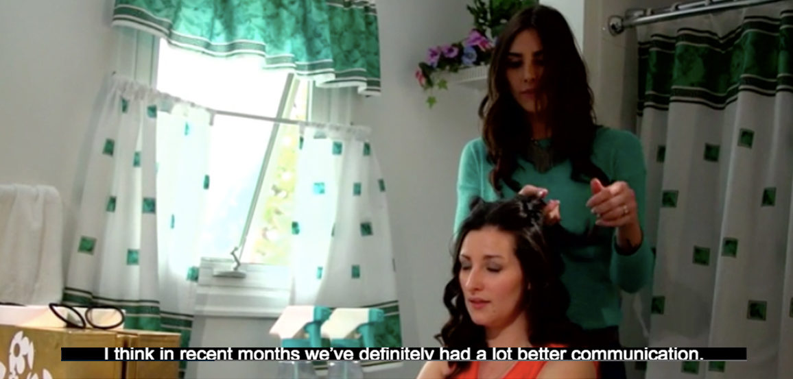Woman cutting another woman's hair