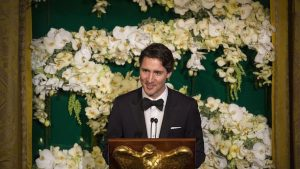 Justin Trudeau speaking at a podium