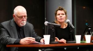 Robert Washburn and Gretchen King speaking at a podium