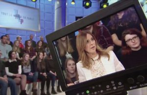 Julie Snyder on camera with audience in the background