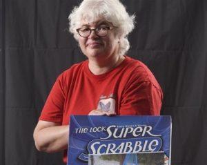 Carol Patenaude next to The Lock: Super Scrabble