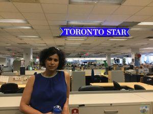 Shree Paradkar in front of Toronto Star sign