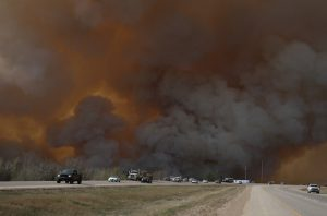 Many residents evacuated the city as Fort McMurray became embroiled with flames / Photo courtesy Robert Murray / Fort McMurray Today