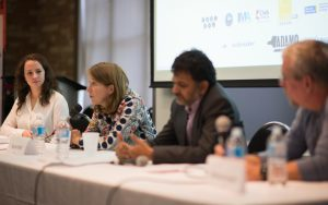 Emma McIntosh, Rachel Pulfer, Saurabh Dani and Mathew Ingram speaking at a conference