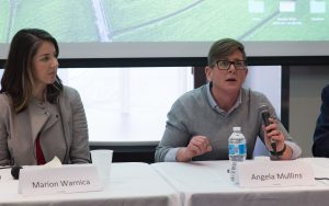 Marion Warnica and Angela Mullins speaking at a conference