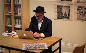 Dave Bidini on a laptop at a desk