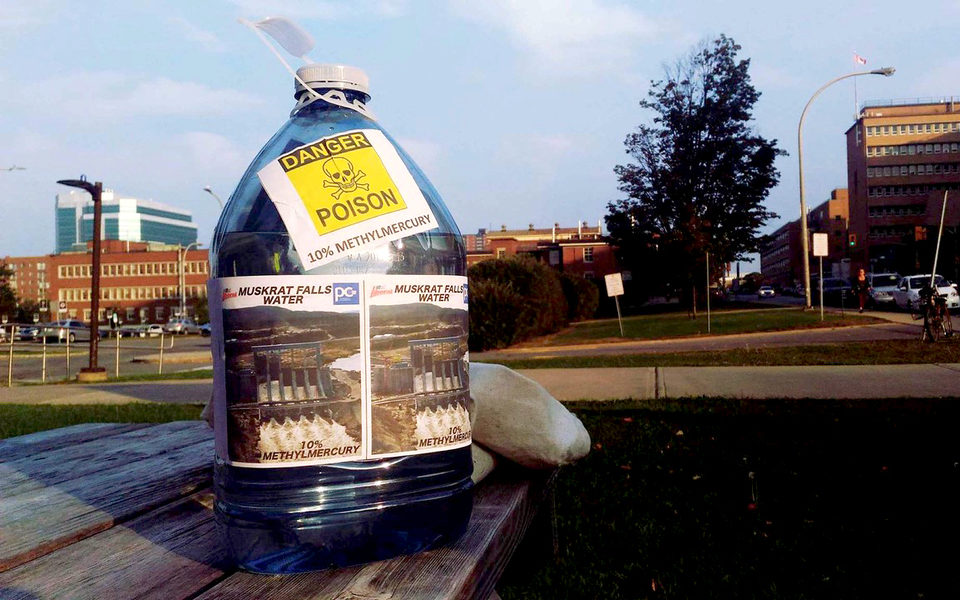 """On Oct. 2, 2017 about two dozen demonstrators marched up Yonge Street to voice their concerns to a wider audience in a different city. They eventually entered the office of Minister Carolyn Bennett and presented her with a bottle of what they called """"muskrat Falls methylmercury poisoned water."""" (Submitted by Matthew Behrens)"""