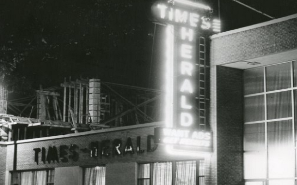 Times Herald fluorescent sign black and white photo