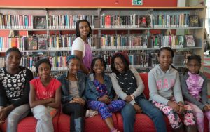Annette Bazira-Okafor (back) with some of the girls from Black Girls Magazine.
