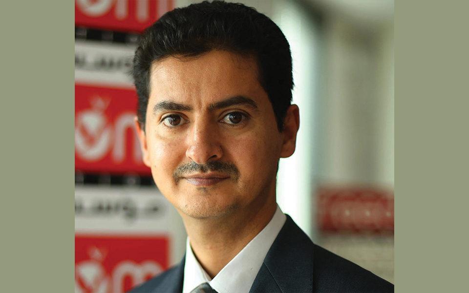 A headshot of journalist Khaled Al-Hammadi
