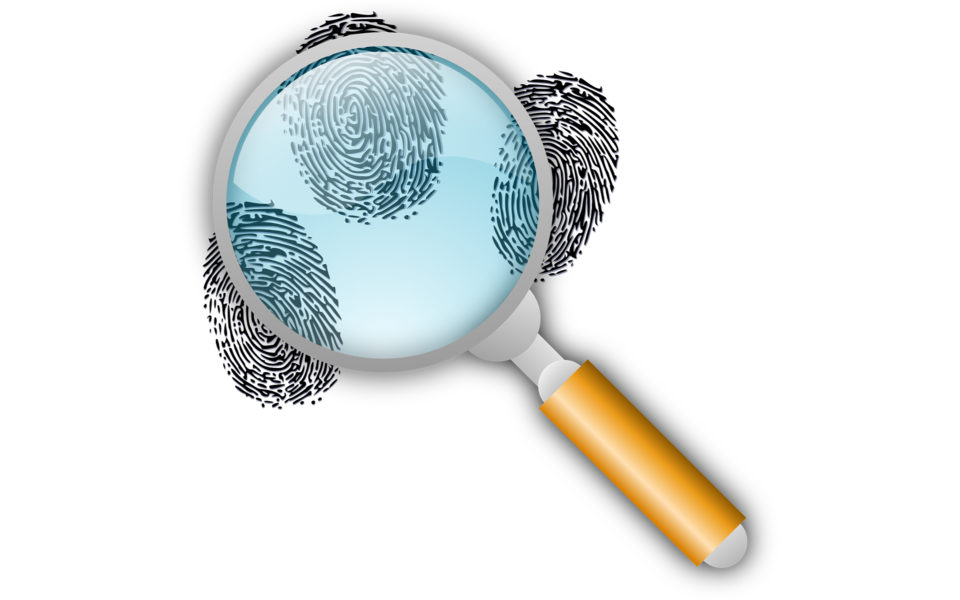 A magnifying glass examining finger prints