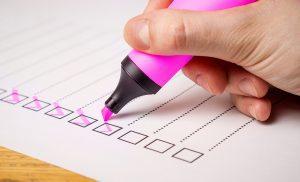 A pink highlighter checks off a list