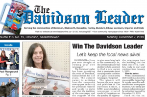 "The front page of the Davidson Herald paper. Under the title of the paper is a photo of Tara de Ryk on the left, holding two papers. On the right is an article called ""Win The Davidson Herald!"" with the subhead ""Let's keep local journalism alive."""