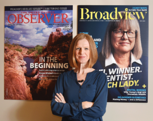 Editor of the Broadview magazine, Jocelyn Bell stands with her arms crossed facing the camera.