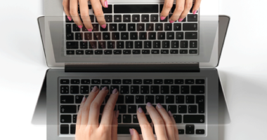 Descriptive image of hand typing on a keyboard