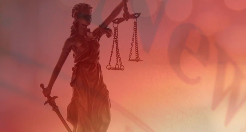 A statue of Lady Justice appears over
